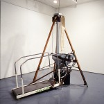 Mowry Baden. Chickenfeed., 1984, wood, steel, aluminium, rubber, chickenfeed. Installation view. Photo: Peter MacCallum