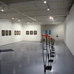 """From left to right: Gerard Pas. Triptych I., Triptych II., Triptych III., Red-Blue Crutches 1-12"""", and  Are-Invented Object. From left to right: Gerard Pas. Red-Blue Wheelchair., Triptych I., Triptych II., and . Installation view. West Gallery. Photo: Peter MacCallum.Installation view. West Gallery. Photo: Peter MacCallum."""