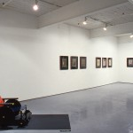 From left to right: Gerard Pas. Red-Blue Wheelchair., Triptych I., Triptych II., and Triptych III. Installation view. West Gallery. Photo: Peter MacCallum.