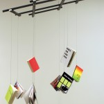Derek Sullivan, December 19, 2010, 2010. Nine print-on-demand artist's books, wood, fasteners, airline cable. Photo: Jon Sasaki.