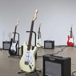 Matt Rogalsky, Discipline, 2011. Twelve Fender Stratocaster guitars, amplifiers, computer script, FM radio signal, dimensions variable. Detail. Photo: Toni Hafkenscheid.